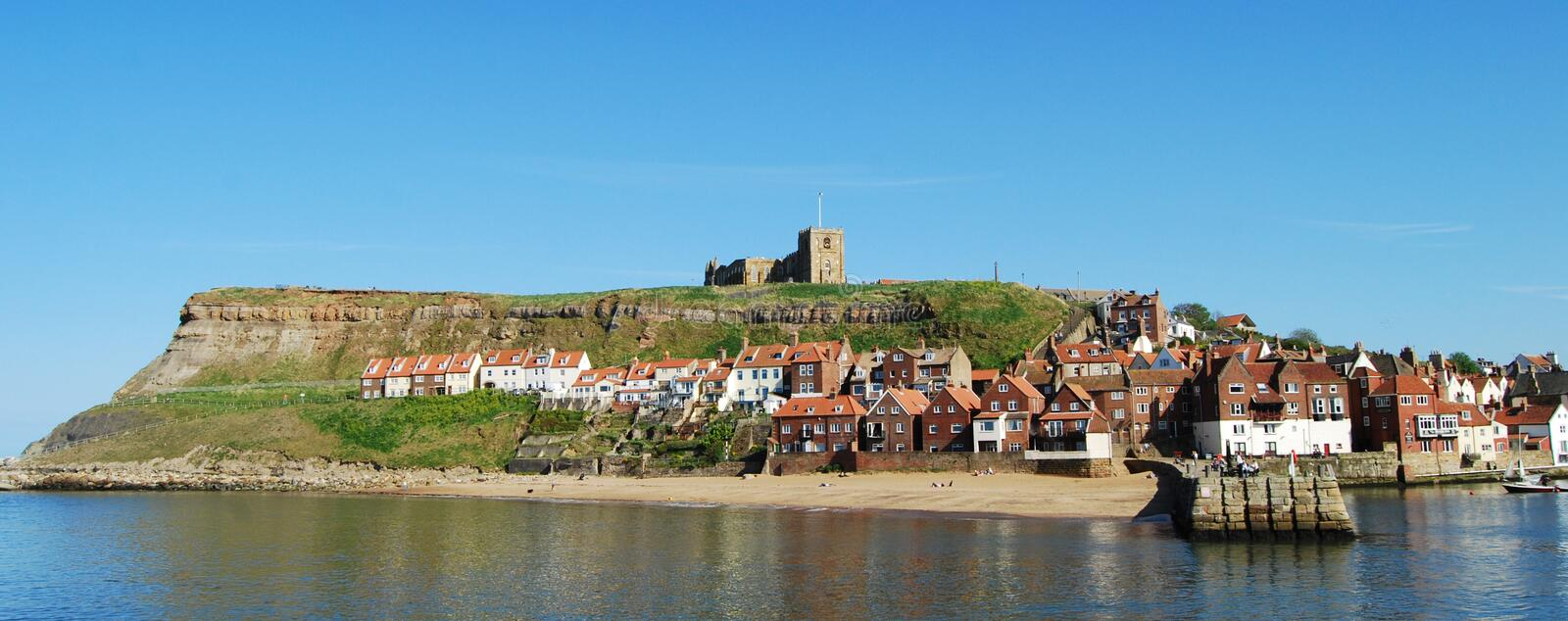Whitby fishing town and Abbey, North Yorkshire. Whitby Abbey is a ruined Benedictine abbey overlooking the North Sea on the East Cliff above Whitby in North stock photo