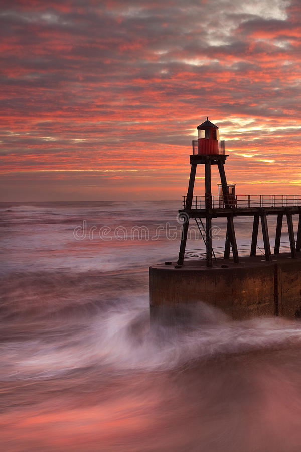 Whitby Pier as the sun rises stock images