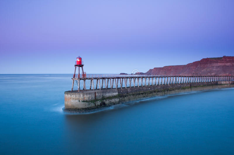 Whitby pier at dusk stock image
