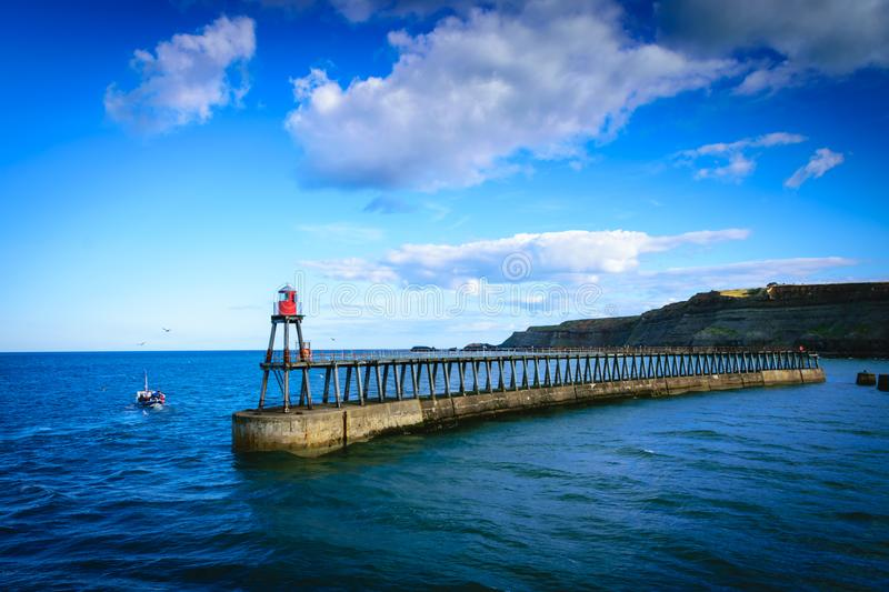 Whitby pier at the harbor entrance at Whitby in North Yorkshire, UK stock images