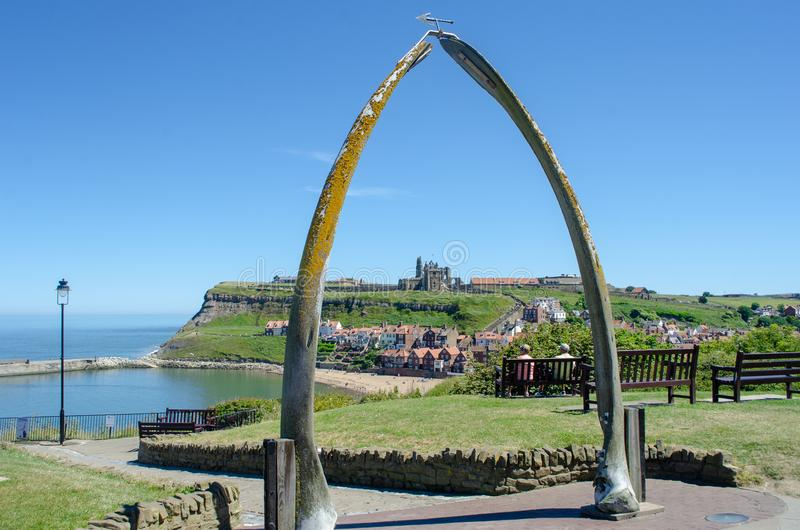 Looking down on Whitby through Whalebone sculpture. Whitby Yorkshire UK - 25 June 2018: Looking down on Whitby through Whalebone sculpture royalty free stock photography