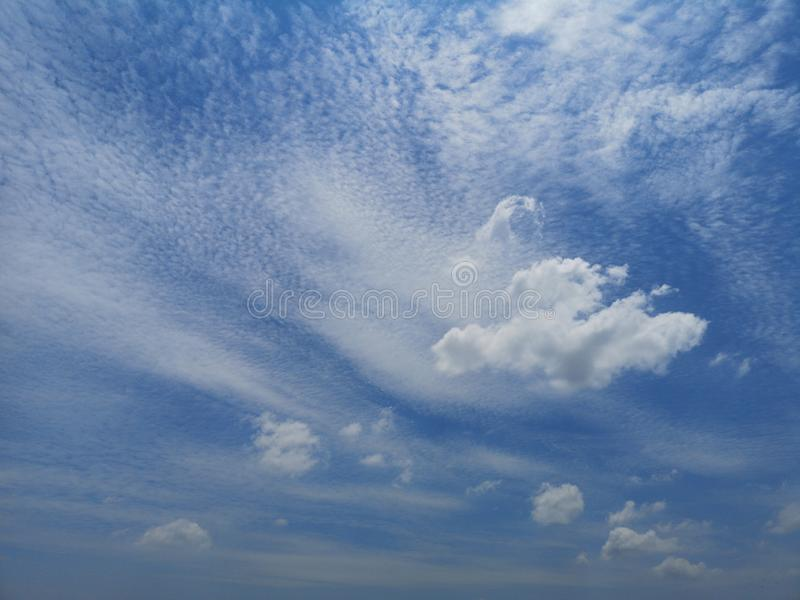 White clouds in the blue sky Cloudy natural background space for write beautiful nature royalty free stock images