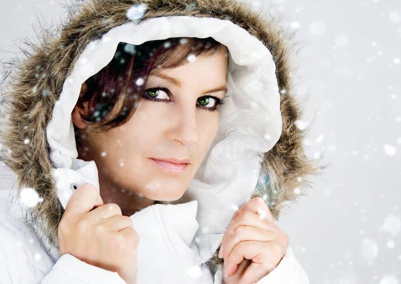 White 2. Snowy fashion shot of a woman in white royalty free stock photos