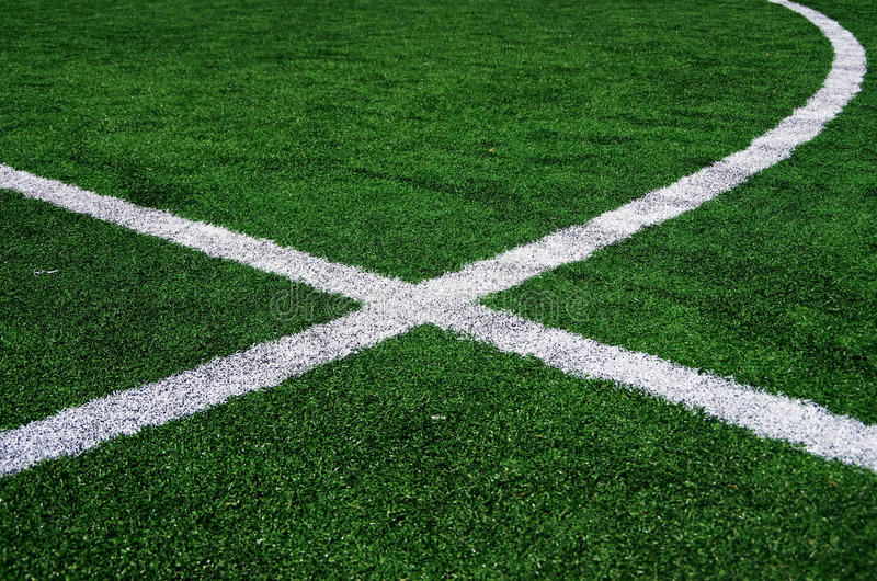 White abstract lines on a green field. White abstract lines on a green football field royalty free stock image