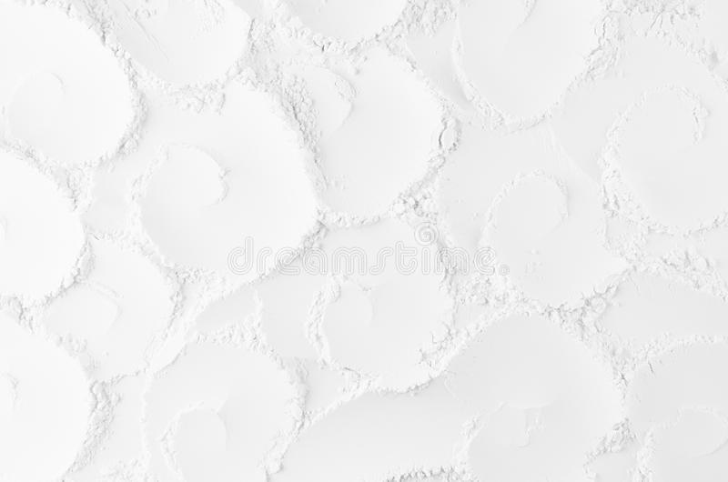 White abstract soft smooth plaster background with curl spiral rose pattern. royalty free stock images