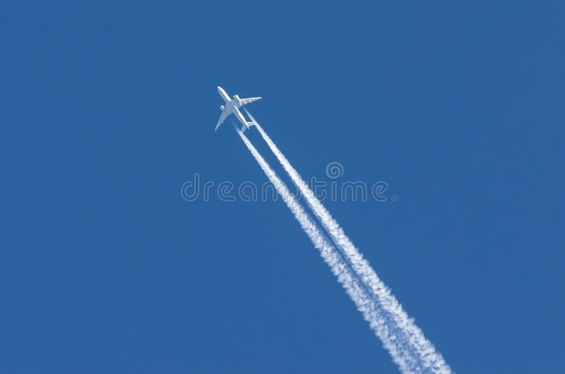 White aircraft big two engines aviation airport contrail clouds.  stock photo