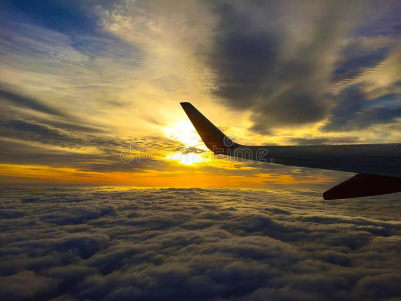 White Airplane Flying on Blue and Grey Sky stock photography