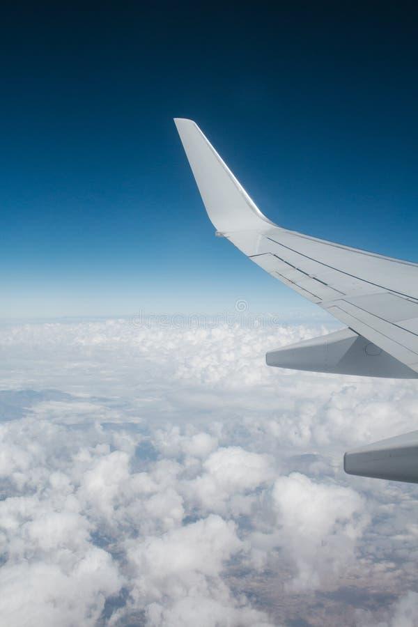 White Airplane over the White Sky royalty free stock photos