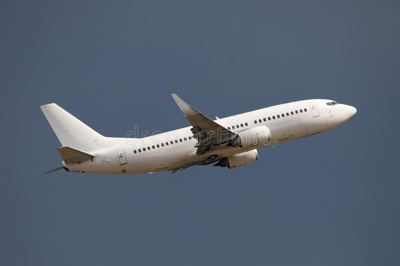 White airplane. Take off in cloudy and stormy day royalty free stock photos