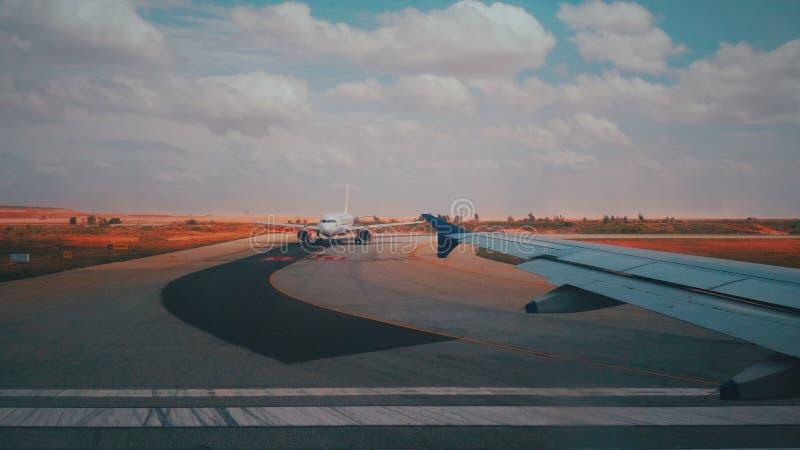 White Airplane on Track royalty free stock photos