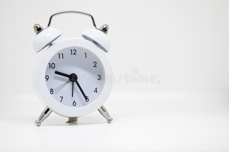 White alarm clock on white background stock photography