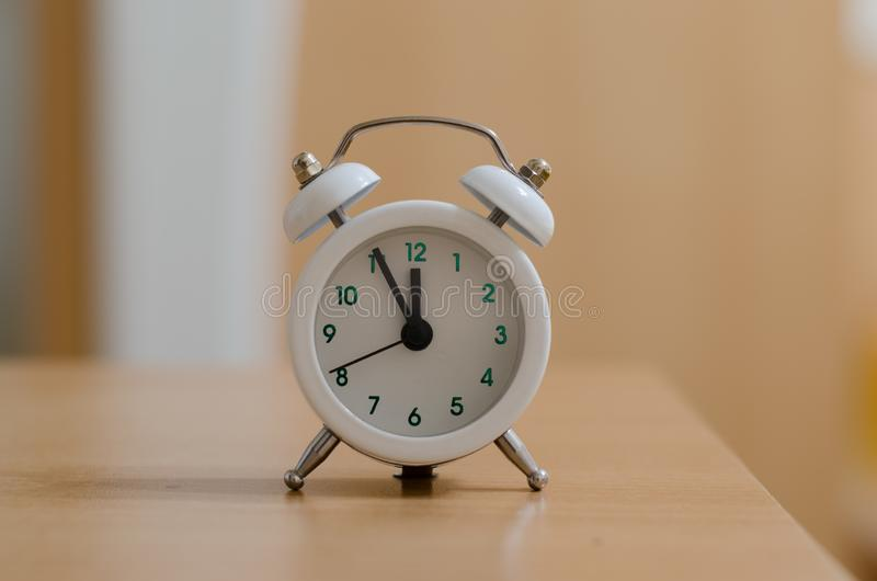 White alarm clock closeup. Blurred background royalty free stock photos