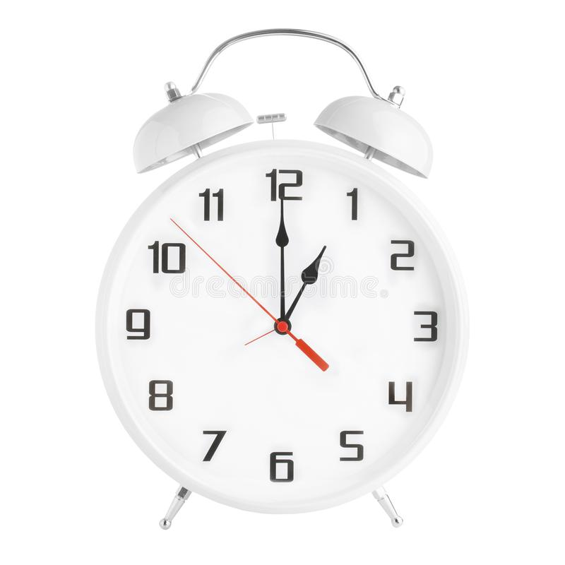White alarm clock showing one o`clock isolated on white background. Twin bell clock alarm clock isolated on white background royalty free stock photography