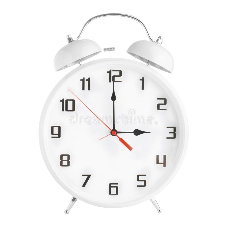 White alarm clock showing three o`clock isolated on white background. royalty free stock photography