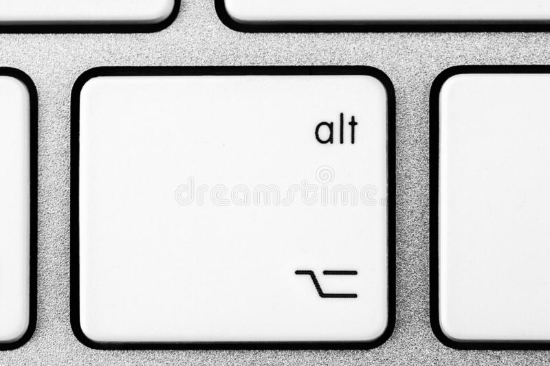 White ALt button close up. Elements of a white computer keyboard close up stock image