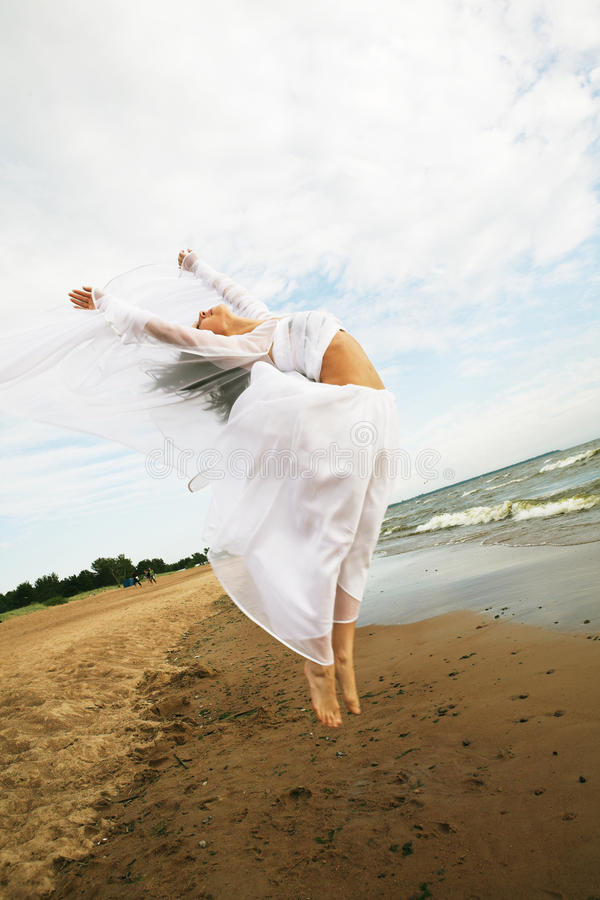 White angel on the beach stock image