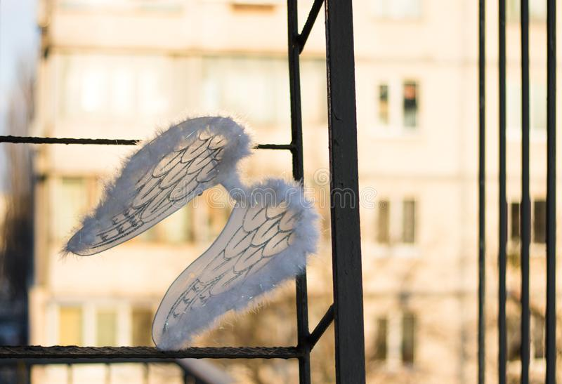 White angel wings on the stairs royalty free stock photography
