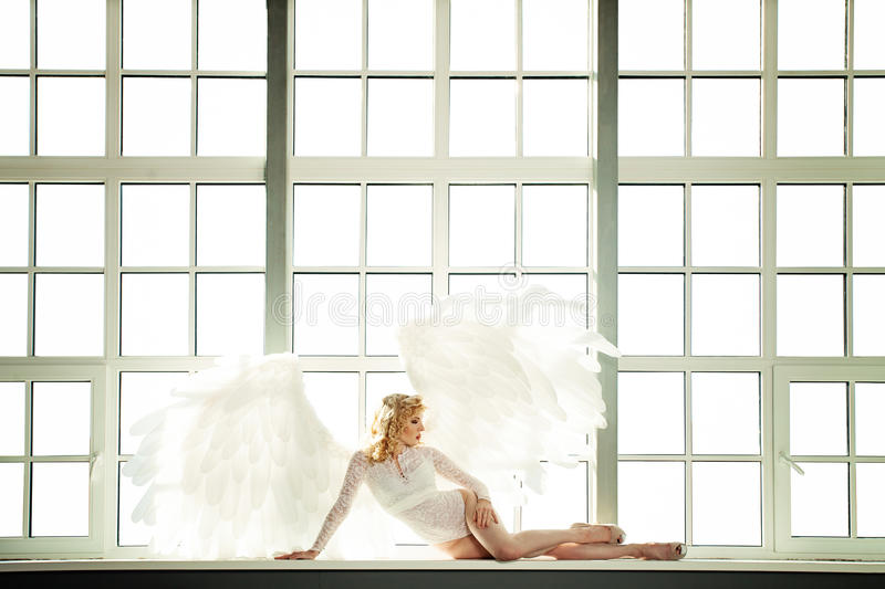 White Angel Woman with Feathers Wings stock photography