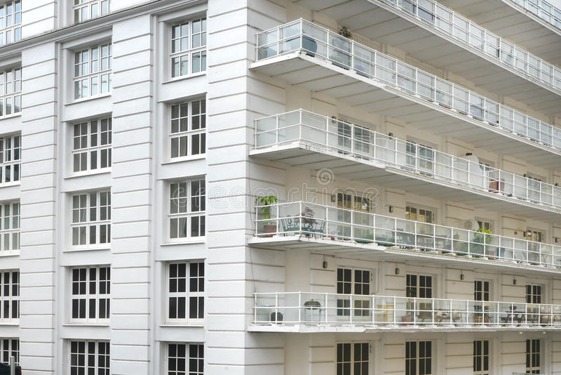 White apartment building stock images