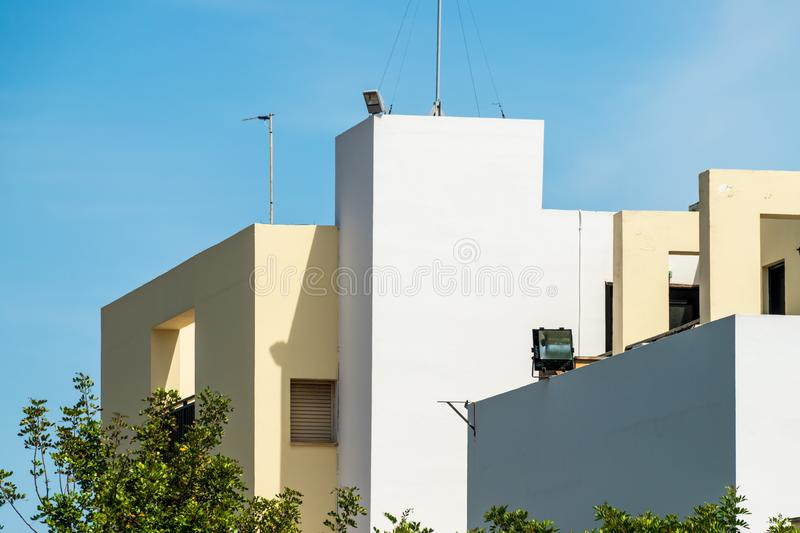 Modern apartment buildings on a sunny day with a blue sky. Facade of a modern apartment building. White apartment buildings on a sunny day with a blue sky royalty free stock images