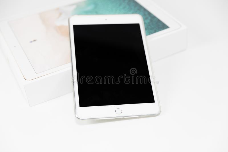 White Apple iPad Gold with box on white background closeup royalty free stock photography