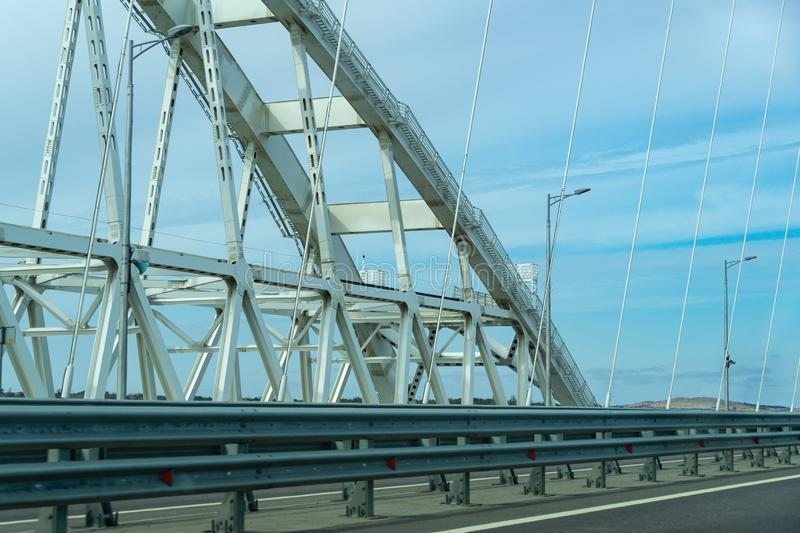 White arches of new Crimean Bridge, also called Kerch Bridge, through Kerch Strait to Crimea. Automobile and railway bridge royalty free stock photography