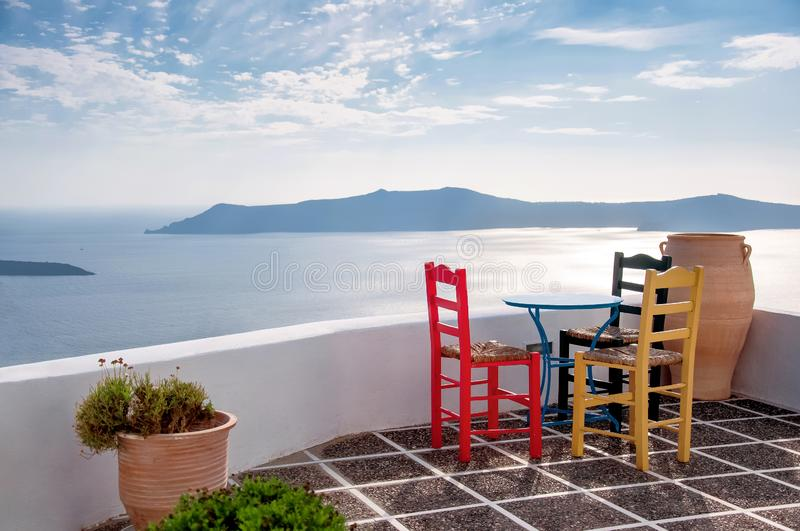 White architecture on Santorini island, Greece, Aegean sea, Europe. Beautiful summer landscape, sea view. Restaurant with table. And chairs, caldera view stock photo