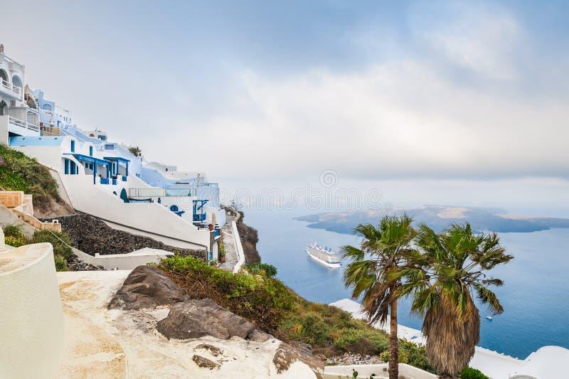 White architecture on Santorini island, Greece. Foggy morning. Beautiful landscape with sea view stock photo