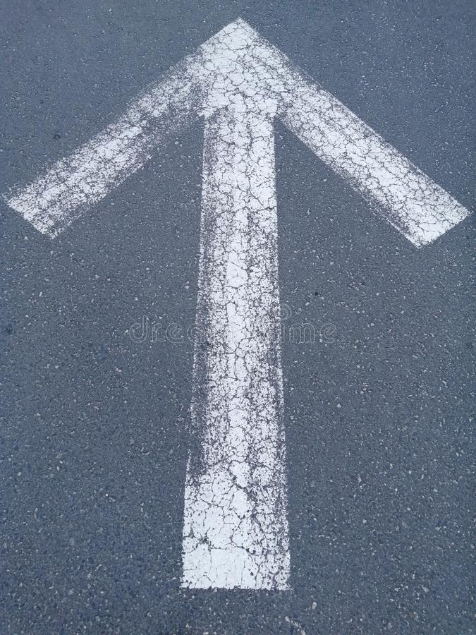White Arrow.Forward signs on the road.Grey background stock photo