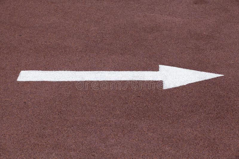 White arrow over red sport track, right move stock image