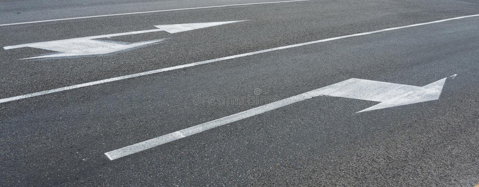 White arrows pointing directions Regulatory road sign proceed in direction indicated by arrow traffic royalty free stock photography
