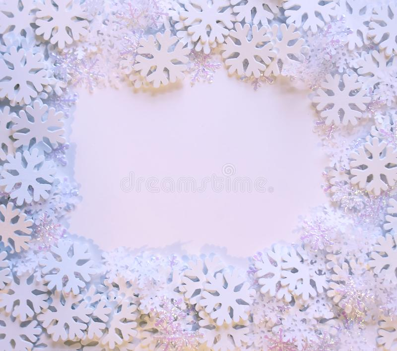 White snowflakes on soft background. Winter frame background. Decorative template for cards, banner, poster stock photo