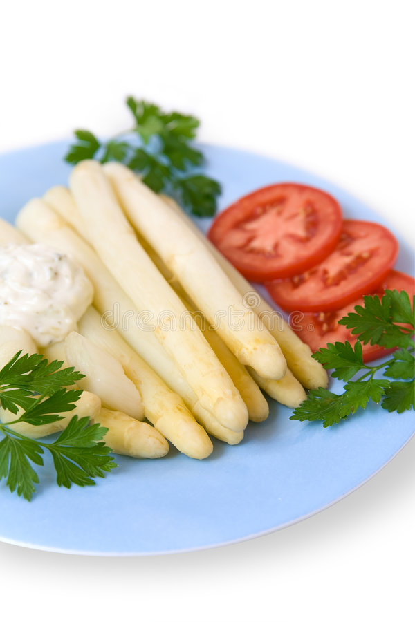 White asparagus. Cooked white asparagus with salad, tomato, parsley and dressing royalty free stock photos