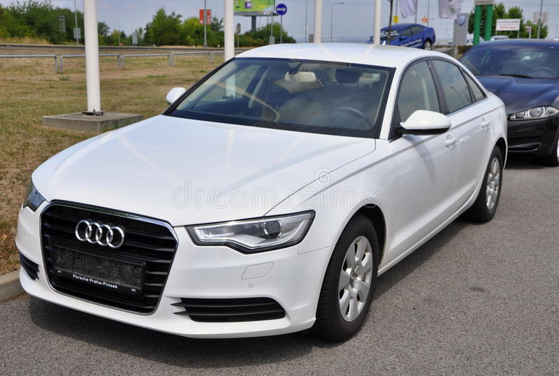 PRAGUE, THE CZECH REPUBLIC, 02.08.2015   Brand New White Audi A6 Parks In  Front Of Car Store Audi