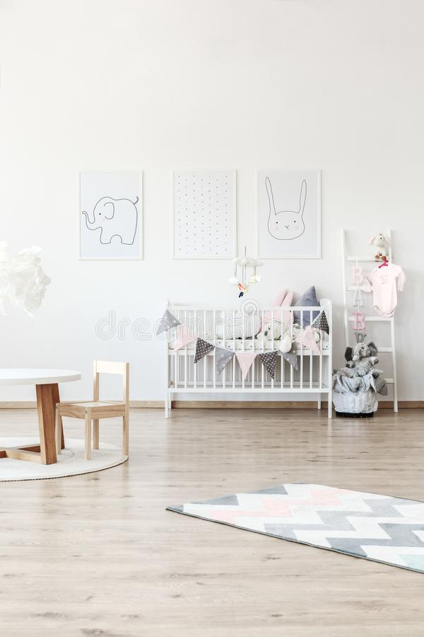 White baby`s bed in room royalty free stock photography