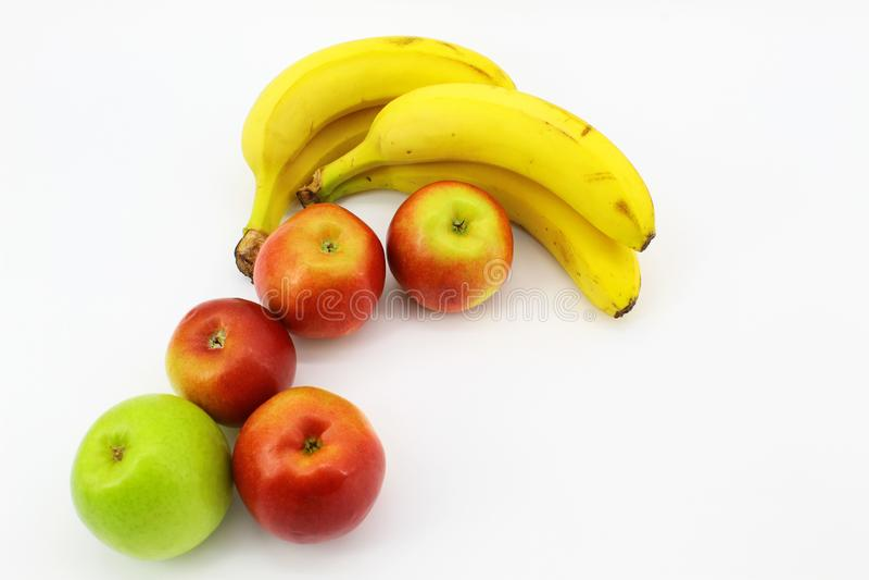 Sunny fruit mood: bananas and apples royalty free stock photo