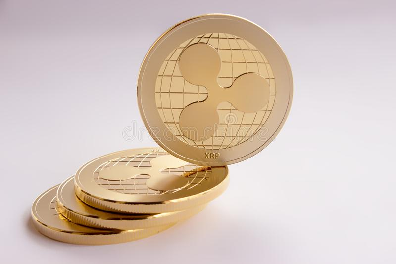 Crypto digital currency - gold coins ripple xrp. On the white background are gold coins of a digital crypto currency - ripple xrp. On the inclined plane composed royalty free stock photo