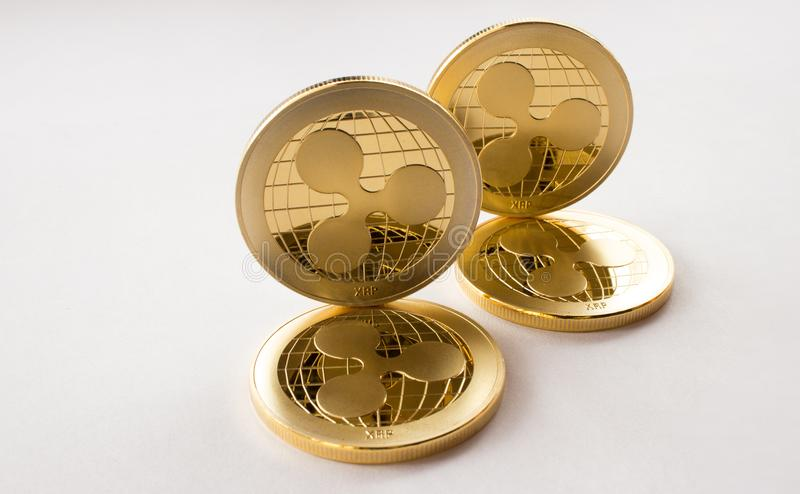 Digital crypto currency gold coins ripple xrp. On the white background are gold coins of a digital virtual crypto currency - ripple - xrp. In addition to the stock photography