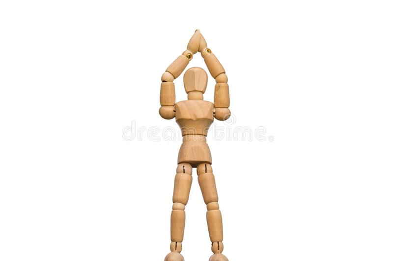 Isolated wooden figure makes a victory pose stock photo