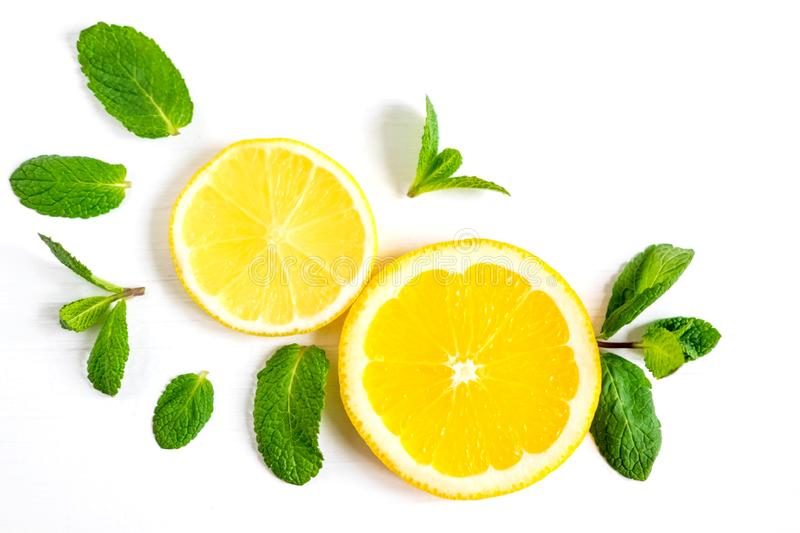 White background with lemon, orange slices and mint. Concept with fresh fruit. Lemon, Orange, Mint. View from above stock photography