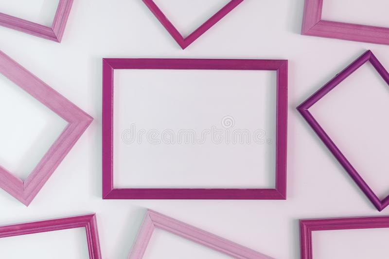 On a white background, a lot of dark pink blank frames are laid out. Space for text, layout. Unusual concept stock photo