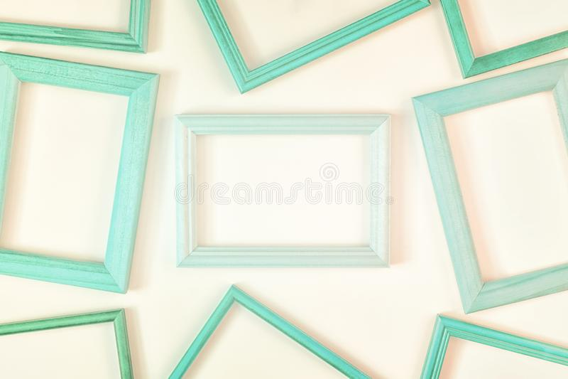 On a white background a lot of turquoise empty frames are laid out. Space for text, layout. Unusual concept royalty free stock photo