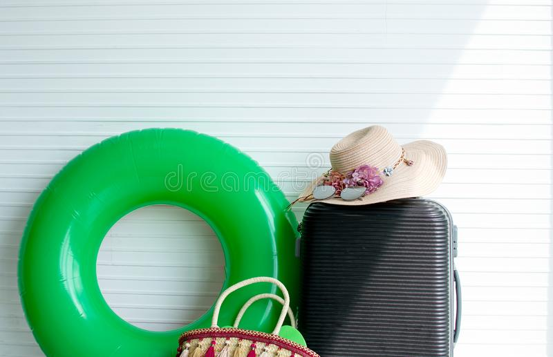 White background with luggage and woman`s accessories royalty free stock photo