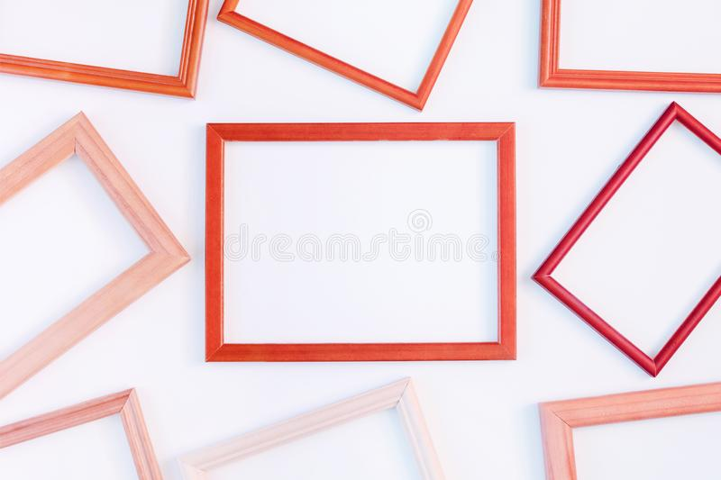 On a white background many red empty frames are laid out. Space for text, layout. Unusual concept royalty free stock photos