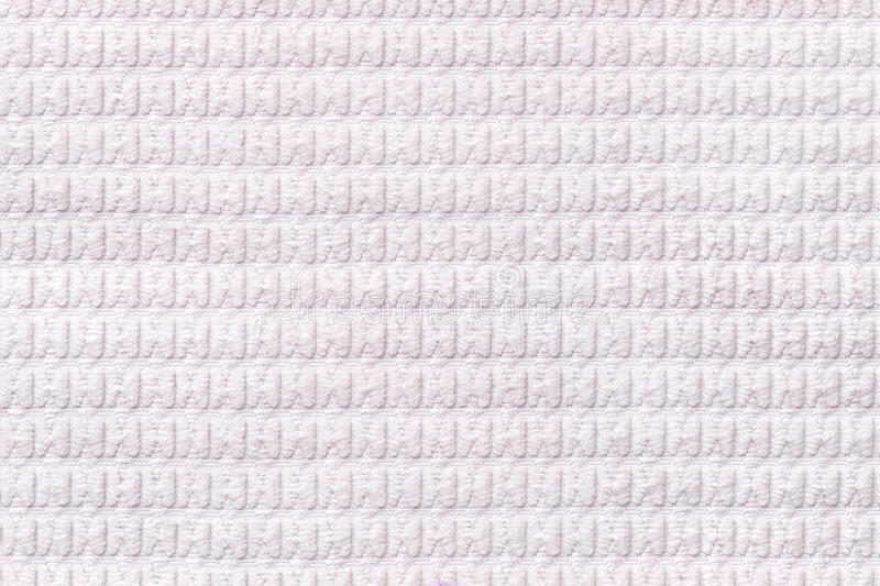 White background from soft fleecy fabric close up. Texture of textiles macro.  royalty free stock images
