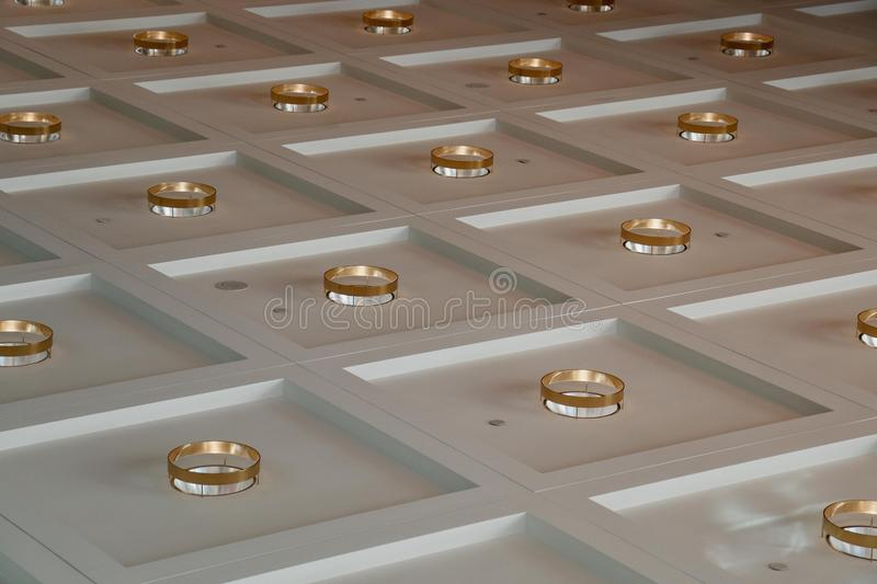 Background squared with gold circles. White background and squares, and in the middle of square some gold circles royalty free stock photography