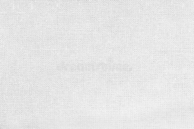 White background from a textile material. Fabric with natural texture. Backdrop. White background from a textile material with wicker pattern, closeup. Structure stock images
