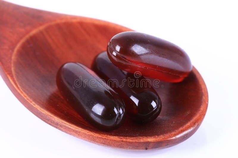 Krill oil capsule. White background translucent krill oil capsules stock images