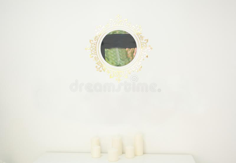White backgroung with a mirror and candles royalty free stock photography