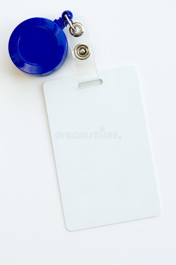 White badge ID card